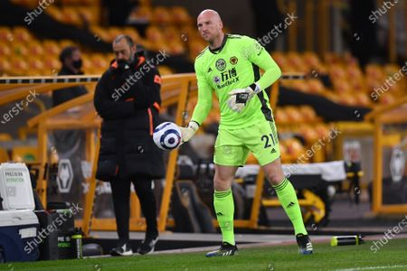 Goalkeeper John Ruddy of Wolverhampton warms up before substituting Rui Patricio after his injury during the English Premier League soccer match between Wolverhampton Wanderers and Liverpool FC in Wolverhampton, Britain, 15 March 2021.