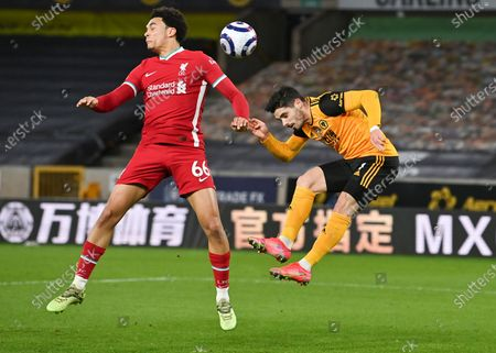 Liverpool's Trent Alexander-Arnold, left, and Wolverhampton Wanderers' Pedro Neto battle for the ball during the English Premier League soccer match between Wolverhampton Wanderers and Liverpool at Molineux Stadium in Wolverhampton, England