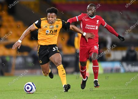 Wolverhampton Wanderers' Adama Traore, left, and Liverpool's Naby Keita battle for the ball during the English Premier League soccer match between Wolverhampton Wanderers and Liverpool at Molineux Stadium in Wolverhampton, England
