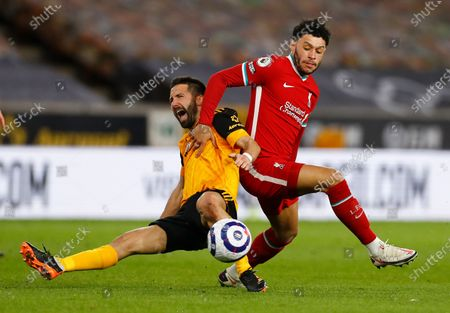 Stock Picture of Wolverhampton Wanderers' Joao Moutinho and Liverpool's Alex Oxlade-Chamberlain battle for the ball during the English Premier League soccer match between Wolverhampton Wanderers and Liverpool at Molineux Stadium in Wolverhampton, England