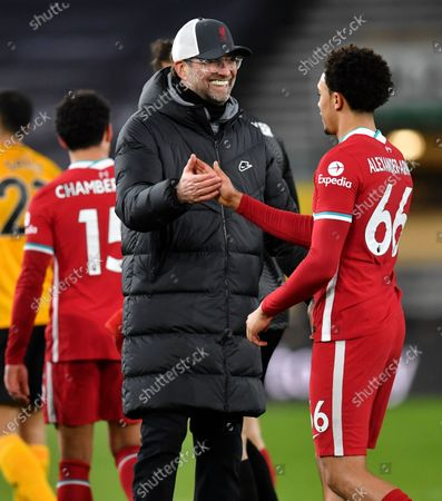 Liverpool's manager Jurgen Klopp celebrates with Trent Alexander-Arnold following the English Premier League soccer match between Wolverhampton Wanderers and Liverpool at Molineux Stadium in Wolverhampton, England