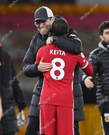 Liverpool's manager Jurgen Klopp embraces Liverpool's Naby Keita following the English Premier League soccer match between Wolverhampton Wanderers and Liverpool at Molineux Stadium in Wolverhampton, England