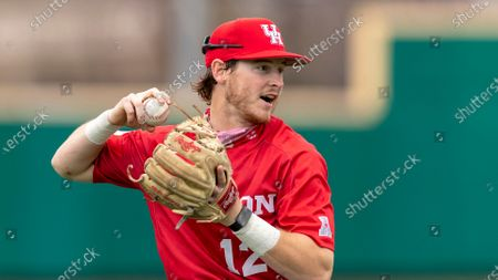 Houston short stop Ian McMillan makes the relay catch and throw to stop the Texas State runner from advancing during an NCAA baseball game, in San Marcos, Texas