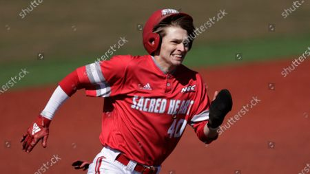 Stock Image of Sacred Heart's Mark Smith runs home against Hofstra during an NCAA baseball game, in Hempstead, N.Y