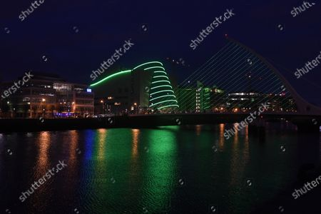 The Samuel Beckett Bridge and the Convention Centre in Dublin City, Ireland, 15 March 2021 are lit up green for the Saint Patrick's festival. For the second year running the festival will not take place due to COVID-19 restrictions. Saint Patrick's day is celebrated on 17 March. Ireland has temporaily postponed using the Astra-Zenica vaccine due to health concerns which has slowed down the pace of vaccination.