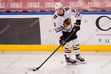 Chicago Blackhawks defenseman Ian Mitchell warms up before the start of an NHL hockey game against the Florida Panthers, in Sunrise, Fla
