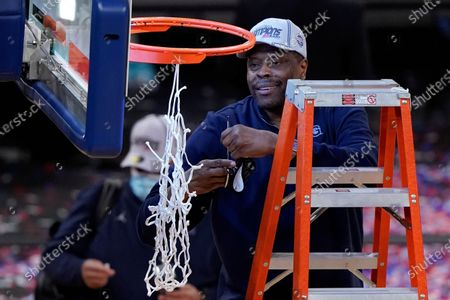 Georgetown head coach Patrick Ewing cuts down the net after an NCAA college basketball game against Creighton in the championship of the Big East Conference tournament, in New York. Georgetown won 73-48