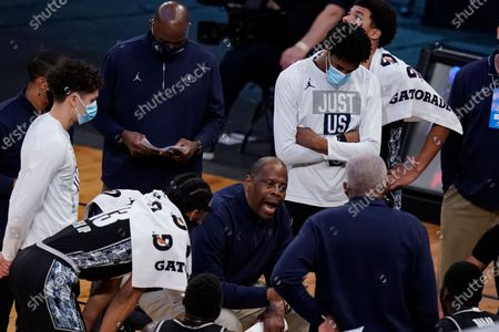 Georgetown head coach Patrick Ewing talks to his players during the first half of an NCAA college basketball game against Creighton in the championship of the Big East Conference tournament, in New York