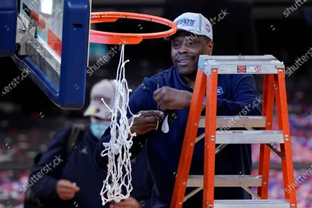 Stock Picture of Georgetown head coach Patrick Ewing cuts down the net after an NCAA college basketball game against Creighton in the championship of the Big East Conference tournament, in New York. Georgetown won 73-48