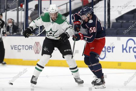 Dallas Stars defenseman Jamie Oleksiak, left, works against Columbus Blue Jackets forward Eric Robinson during an NHL hockey game in Columbus, Ohio, . The Stars won 2-1 in a shootout
