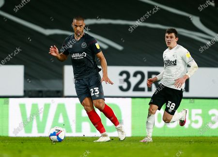 Winston Reid of Brentford and Jason Knight of Derby County