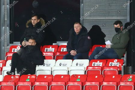 Stock Picture of Gary Neville, Ryan Giggs, Paul Scholes and Roy Keane watch on