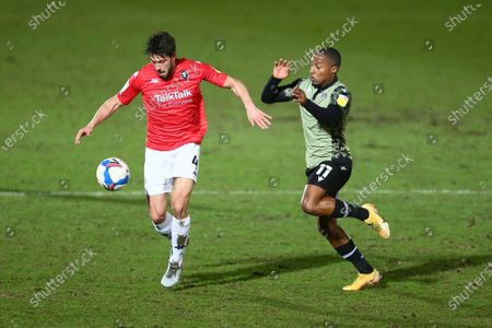 Jason Lowe of Salford City and Callum Harriott of Colchester