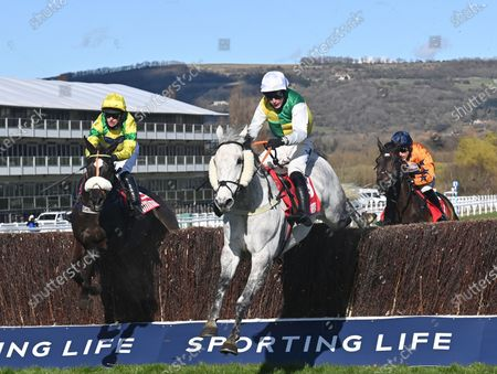 (C) Vintage Clouds (Ryan Mania) takes the last before going on to win The Ultima Handicap Steeple Chase.Photo © Hugh Routledge.