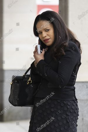 MP Claudia Webbe(Centre) speaks on the phone outside Westminster Magistrates Court .She is charged with one count of harassment and the trial is expected to last for one day.