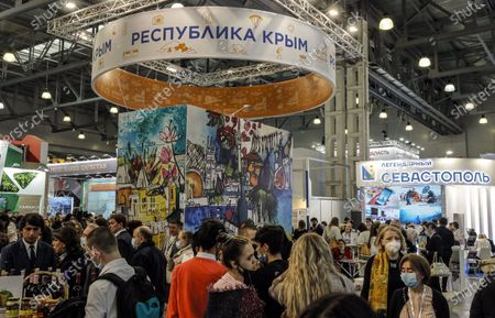 Visitors walk in front of Republic of Crimea's pavilion at the 27th International Travel Show MITT at Crocus Expo Center in Moscow, Russia, 16 March 2021. MITT is the largest B2B travel and tourism trade show in Russia, attracting representatives of the Russian and the international tourism industry.