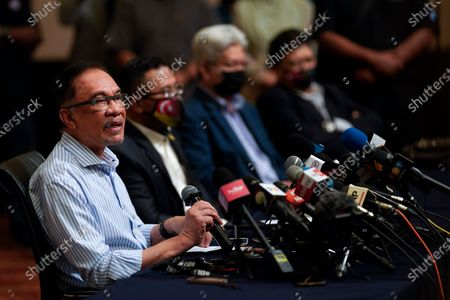 Stock Picture of Malaysian opposition leader Anwar Ibrahim, left, speaks during a press conference at a hotel in outskirt of Kuala Lumpur, Malaysia