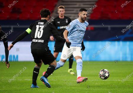Riyad Mahrez of Manchester City ands Lars Stindl of Borussia Monchengladbach