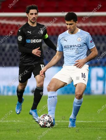 Rodrigo of Manchester City and Lars Stindl of Borussia Monchengladbach