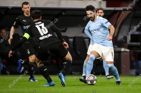 Ilkay Gundogan of Manchester City and Lars Stindl of Borussia Monchengladbach