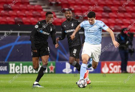 Rodrigo of Manchester City and Denis Zakaria of Borussia Monchengladbach