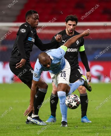 Fernandinho of Manchester City with Denis Zakaria of Borussia Monchengladbach and Lars Stindl of Borussia Monchengladbach