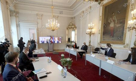 Austrian Chancellor Sebastian Kurz, second right, Bulgaria's Prime Minister Boyko Borissov, Slovenia's Prime Minister Janez Jansa and Czech Prime Minister Andrej Babis sit at a video conference at the federal chancellery in Vienna, Austria