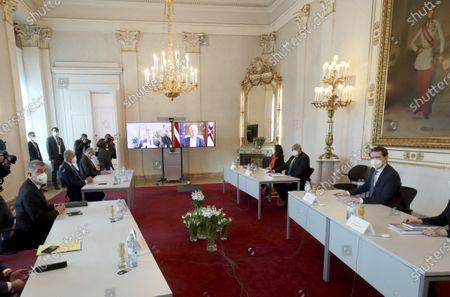 Austrian Chancellor Sebastian Kurz, right, Bulgaria's Prime Minister Boyko Borissov, Slovenia's Prime Minister Janez Jansa and Czech Prime Minister Andrej Babis sit at a video conference at the federal chancellery in Vienna, Austria