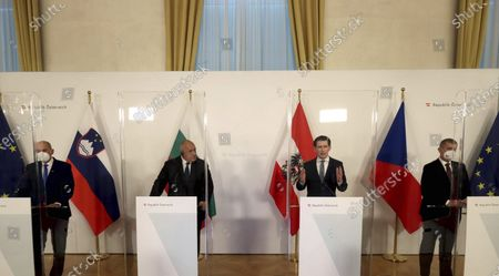 Slovenia's Prime Minister Janez Jansa, Bulgaria's Prime Minister Boyko Borissov, Austrian Chancellor Sebastian Kurz and Czech Prime Minister Andrej Babis, from left, address the media behind plexiglass shields during a joint press conference the federal chancellery in Vienna, Austria