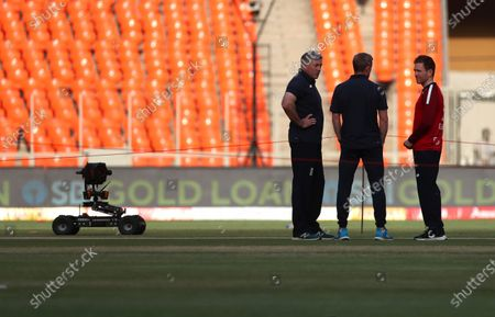 England's captain Eoin Morgan, right, interacts with head coach Chris Silverwood, left, and assistant coach Paul Collingwood after inspecting the pitch ahead of the third Twenty20 cricket match between India and England at Narendra Modi Stadium in Ahmedabad, India