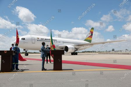 An Air Zimbabwe airplane arrives with a  consignment of covid-19 Sinopharm vaccines at the Robert Mugabe International airport, Harare, Zimbabwe, 16 March 2021. This  included 200,000 doses donated and 144,000 bought by the Government of Zimbabwe from Sinopharm in China. The consignment comes a month after the arrival of the first vaccine shipment in February.                .