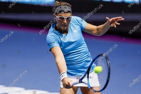 Kirsten Flipkens of Belgium returns the ball to Katerina Siniakova of Czech Republic during their WTA St. Petersburg Ladies Trophy 2021 tennis tournament first round match on March 16, 2021 at Sibur Arena in Saint Petersburg, Russia.