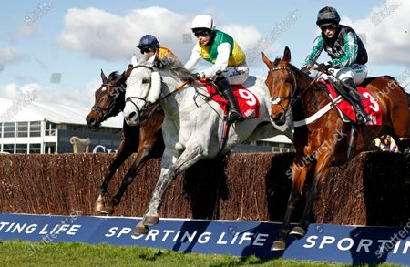 VINTAGE CLOUDS (centre, Ryan Mania) beats PYM (right) in The Ultima Handicap Chase Cheltenham
