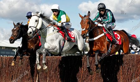 VINTAGE CLOUDS (centre, Ryan Mania) with PYM (right) on his way to winning The Ultima Handicap Chase Cheltenham