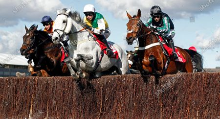 VINTAGE CLOUDS (Ryan Mania) with PYM (right) on his way to winning The Ultima Handicap Chase Cheltenham