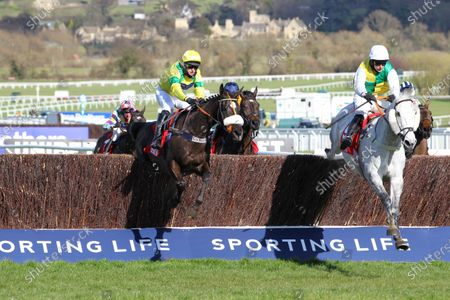 Stock Picture of Vintage Clouds and Ryan Mania [right] win the Ultima Handicap Chase at Cheltenham from Happygolucky.
