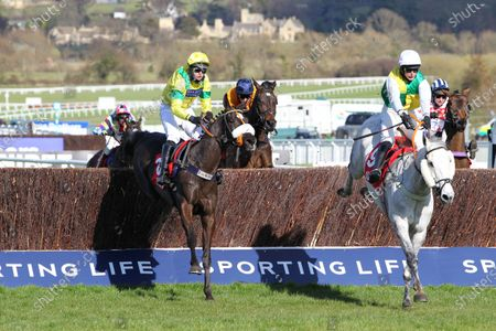 Vintage Clouds and Ryan Mania [right] win the Ultima Handicap Chase at Cheltenham from Happygolucky.