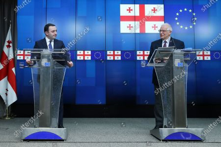 Georgia's Prime Minister Irakli Garibashvili, left, listens to European Union foreign policy chief Josep Borrell during a joint online news conference following a EU-Georgia association council at the European Council headquarters in Brussels