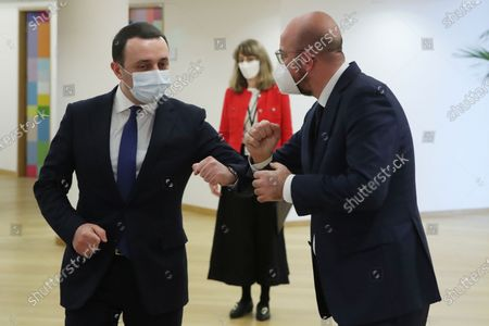 Georgia's Prime Minister Irakli Garibashvili, left, is welcomed by European Council President Charles Michel during their meeting at the European Council headquarters in Brussels