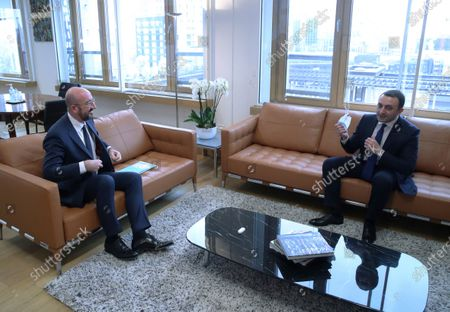 Georgia's Prime Minister Irakli Garibashvili, right, talks to European Council President Charles Michel during their meeting at the European Council headquarters in Brussels