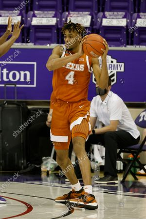 Stock Picture of Texas forward Greg Brown (4) looks to pass the ball against TCU during the second half of an NCAA college basketball game in Fort Worth, Texas