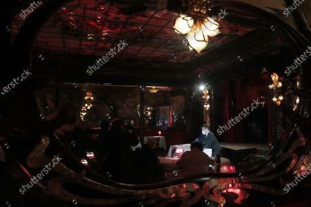 Stock Image of Rodrigo Basilicati-Cardin, President of Pierre Cardin fashion house, is reflected in a mirror as he delivers a press conference at Maxim's restaurant in Paris