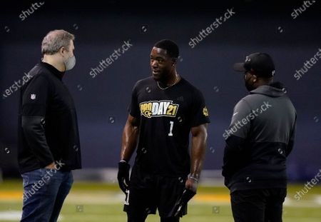 Atlanta Falcons coach Arthur Smith, left, talks with Georgia Tech wide receiver Jalen Camp, center, after the school's Pro Day football workout, in Atlanta