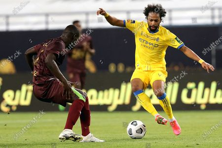 Al-Nassr's player Abdulmajeed Al-Sulaiheem (R) in action against Al-Ain's Badou Ndiaye (L) during the Saudi King's Cup Quarter-final soccer match between Al-Nassr and Al-Ain at King Saud University Stadium, Riyadh, Saudi Arabia, 16 March 2021.
