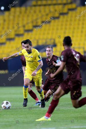 Stock Photo of Al-Nassr's player Petros (L) in action against Al-Ain's Filip Bradaric (2-L) during the Saudi King's Cup Quarter-final soccer match between Al-Nassr and Al-Ain at King Saud University Stadium, Riyadh, Saudi Arabia, 16 March 2021.