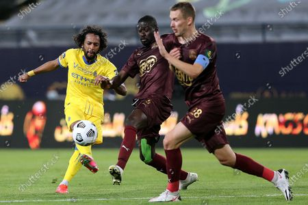 Stock Image of Al-Nassr's player Abdulmajeed Al-Sulaiheem (L) in action against Al-Ain's Badou Ndiaye (C) and Filip Bradaric (R) during the Saudi King's Cup Quarter-final soccer match between Al-Nassr and Al-Ain at King Saud University Stadium, Riyadh, Saudi Arabia, 16 March 2021.