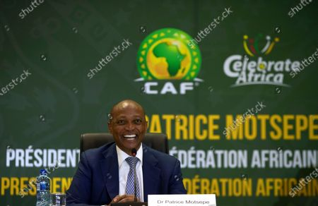 President Patrice Motsepe smiles during a news conference in Johannesburg, South Africa, . South African mining billionaire Motsepe has been elected president of the African soccer confederation without the need for a vote after a deal brokered by FIFA president Gianni Infantino saw his three challengers withdraw