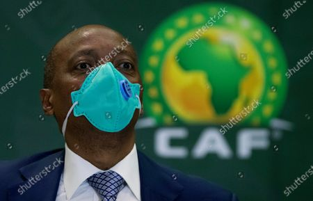 President Patrice Motsepe looks, during a news conference in Johannesburg, South Africa, . South African mining billionaire Motsepe has been elected president of the African soccer confederation without the need for a vote after a deal brokered by FIFA president Gianni Infantino saw his three challengers withdraw