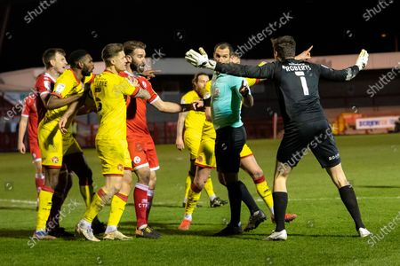 The Walsall players complain to referee Tim Robinson as he gives Crawley Town a penalty in the 97th minute of the EFL Sky Bet League 2 match between Crawley Town and Walsall at The People's Pension Stadium, Crawley