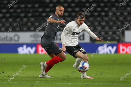 Brentford defender Winston Reid (23) and Derby County midfielder Jason Knight (38) during the EFL Sky Bet Championship match between Derby County and Brentford at the Pride Park, Derby